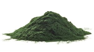 Stack of spirulina algae powder isolated on white background
